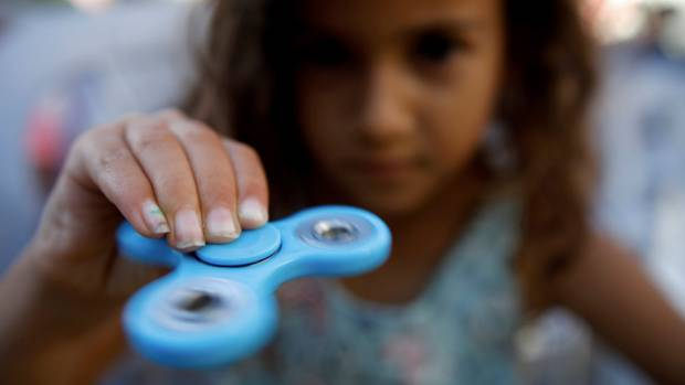 Principal concerned that children that don't have a fidget spinner will feel left out.