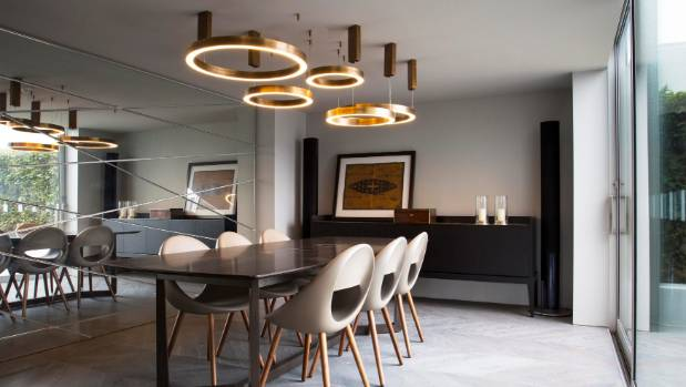 bachelor pad lighting. one entire wall of the dining room is a scored mirror that reflects view back bachelor pad lighting