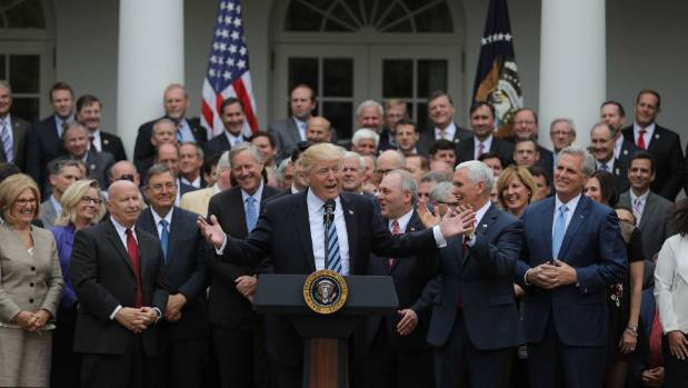 President Donald Trump celebrates after the House of Representatives approved the American Healthcare Act. A subsequent ...