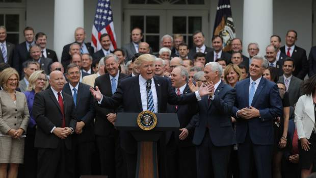 US President Donald Trump  with Congressional Republicans in the Rose Garden of the White House (file photo).