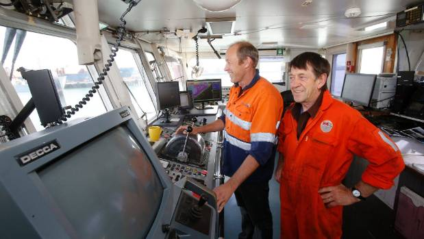 Ship master Scott Rogers, left, and engineer Dave Redington on board the Pelican Suction Dredge during its final visit ...