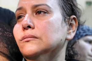 The mother of one of the victims of an attack on a group of Coptic Christians that took place on Friday attends a ...