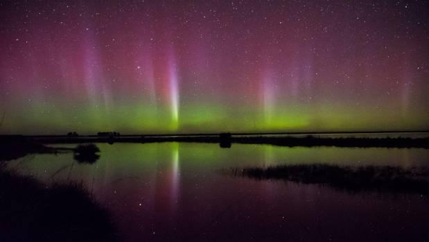 Lake Ellesmere lit up on Sunday night.