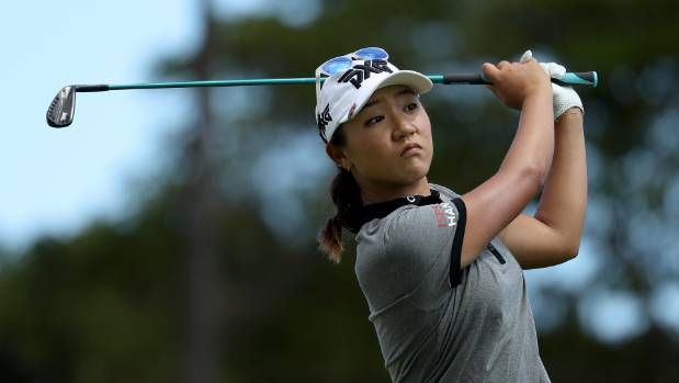 Feng takes 1-stroke lead after bogey-free 66 in Michigan