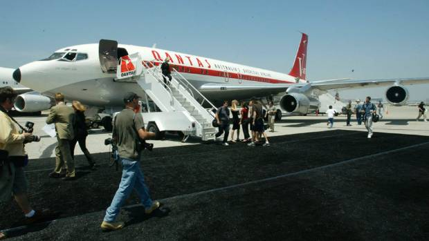the boeing 707 jet owned by actor john travolta sits on the tarmac at los angeles