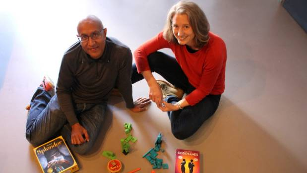Ahmed Bulbulia and Emma Smart with some of the 300 games available at their new gaming cafe Counter Culture.