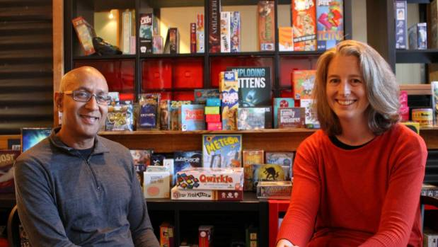 Husband and wife team Ahmed Bulbulia and Emma Smart in front of a selection of board games at their new gaming cafe ...