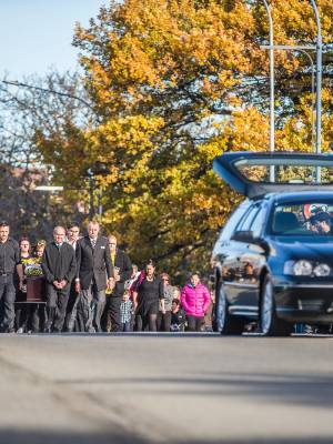 Mourners carry Bevan Moody's casket along the Hutcheson St bridge before a haka.