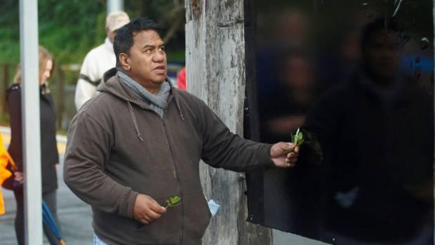 Te Rūnanga o Ngāti Toa chairman Taku Parai performs a blessing.