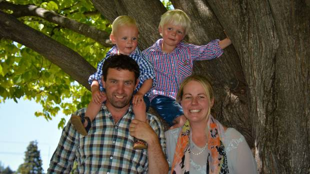 Simon and Sarah Paterson, of the Armidale Merino Stud on the Maniototo Plain, with their young sons Bede and Hugo.