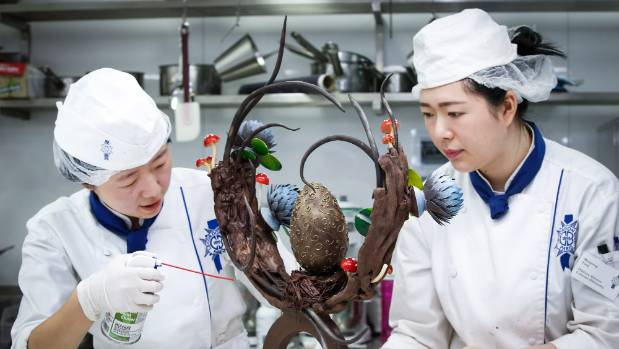 Lingjiie Tu (left) and Mengtong Yang at a chocolate workshop at Wellington's Le Cordon Bleu, where they are studying for ...