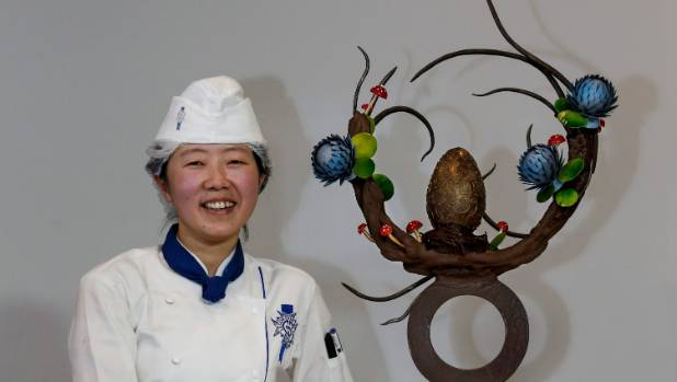 Lingjiie Tu sits proudly by her chocolate workshop creation.