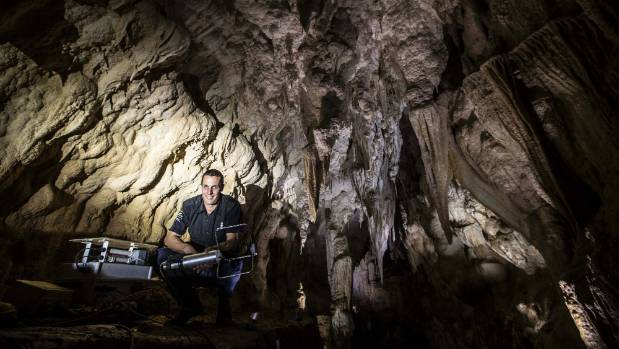 Environmental officer Carl Fischer monitors the cave environment.