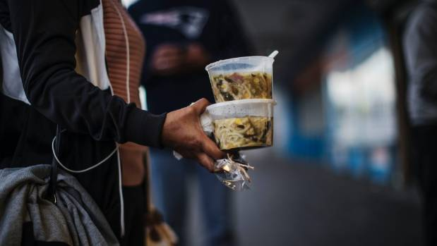 Each person brings what they can: food or drink, items of clothing or blankets they no longer need, to give away for free.