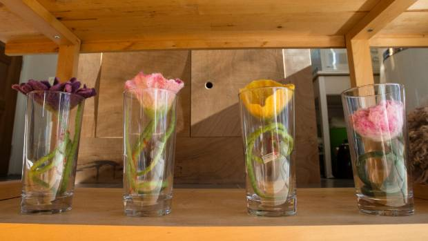 Long-stemmed flowers sitting pretty in glass vases.