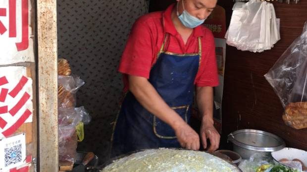 Making a crepe on a side street.
