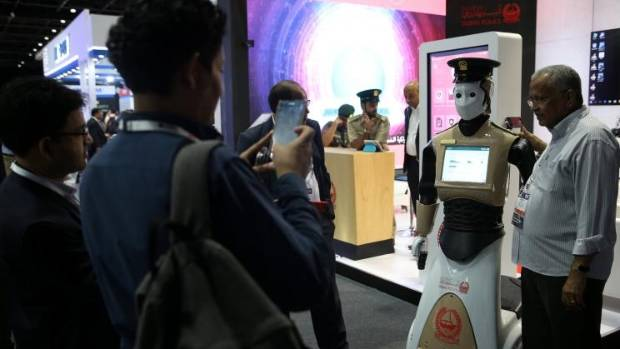 Clad in the colours of the Dubai Police uniform, the life-size robot, can shake hands and perform a military salute.