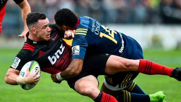 Ryan Crotty, pictured being tackled by Waisake Naholo, injured his ribs against the Highlanders, but could be back in ...