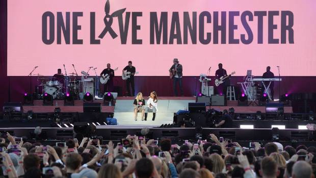 Ariana Grande returns to Manchester to honour victims