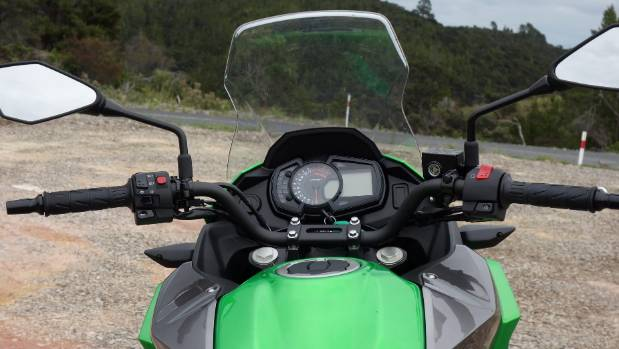 Riding position strikes compromise between standing on pegs for dirt roads or sitting during the morning commute.