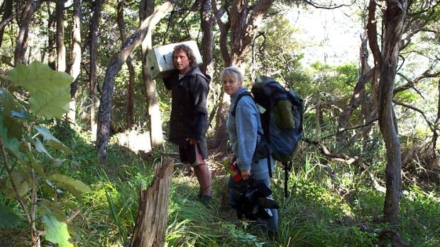 Judy Gilbert with field worker Dean Medlands, taking traps out into the sanctuary in 2003.