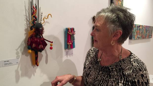 One of the exhibits in the small section of the gallery, currently displaying a tribute to artist Helen Mills, is a ...