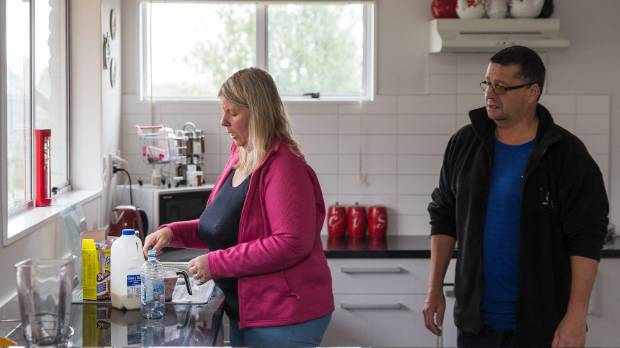 Noeline and Darryll Husband prepare a protein shake to help Noeline's 14-year-old son regain weight.
