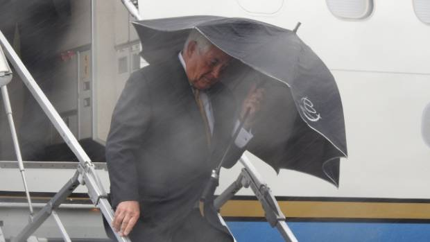 US Secretary of State Rex Tillerson comes face to face with Wellington's weather after landing in New Zealand.