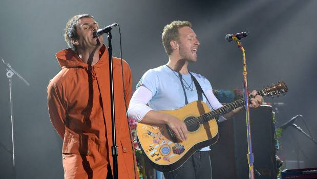 Liam Gallagher and Chris Martin of Coldplay perform on stage during the One Love Manchester Benefit Concert at Old ...
