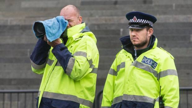 Police photograph protesters at the 350 Aotearoa climate change protest outside Parliament on Tuesday.