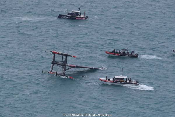 Crew boats respond after Team New Zealand capsize in the start box of their America's Cup challengers series semifinal ...