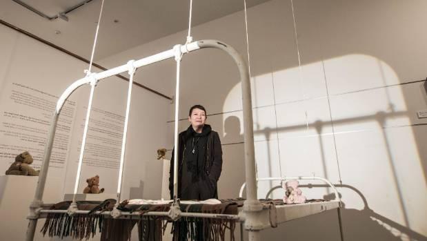 Ann Braunsteiner with work from #lostchildhood at the Nelson Suter Art Society McKee Gallery in Nelson.