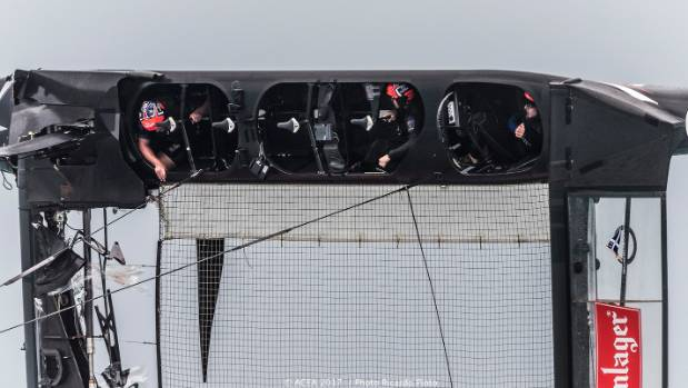 Cyclor Simon van Velthooven, left, was suspended in mid-air after the boat capsized, along with Glenn Ashby and Peter ...