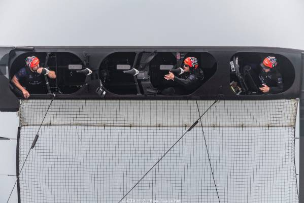 Team New Zealand sailors are trapped in their pods after the their boat pitch-poled.