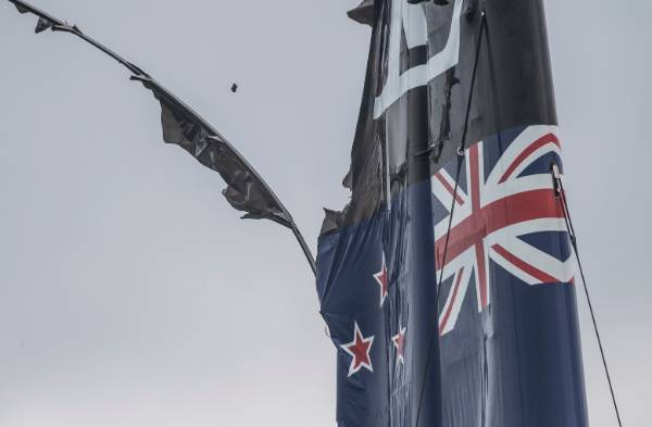 Team New Zealand's main sail is in tatters after their capsize.