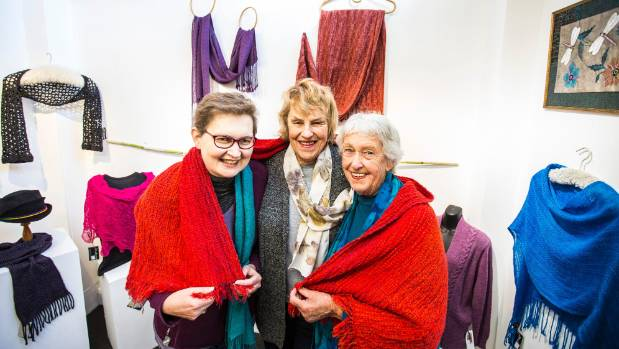 Jane Clark, Diane Harris and Nancye Thomas with work from the 30th birthday exhibition at Fibre Spectrum in Nelson.