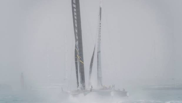 Artemis and Team Japan duel in rough seas during the America's Cup challenger series semifinals.