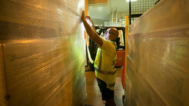 Denis Wanihi, cream plant packing operator at Fonterra's Te Rapa site puts the final touches on for shipping.