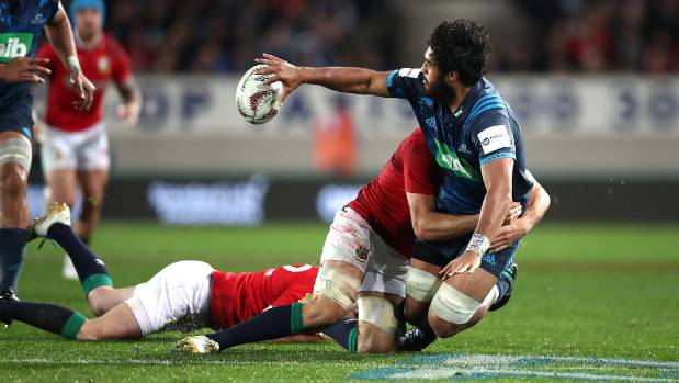 Akira Ioane gets an offload away against the Lions while playing for the Blues.