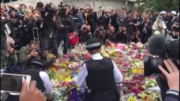 Police lay flowers at Borough Market.