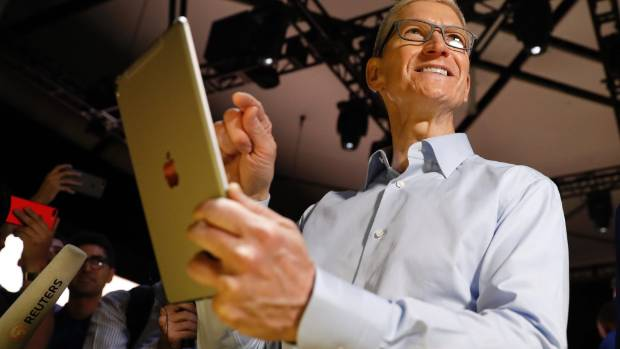 Tim Cook holds an iPad Pro after his keynote address to Apple's annual world wide developer conference.