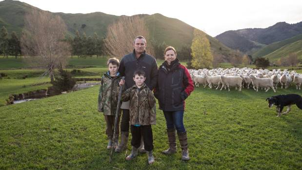 Matt and Lynley Wyeth with their two sons on their Wairarapa sheep and beef farm.