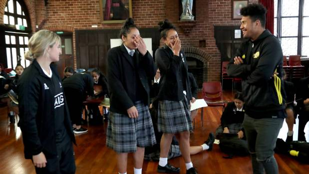 St Mary's College students, rugby stars and sisters Dhys Faleafaga, 16 and Lyric Faleafaga, 17, with Hurricanes star ...