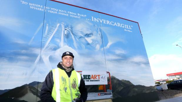 Artist Graham Hoete with his Burt Munro mural that he is working on in Invercargill.