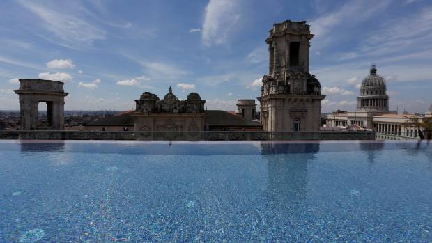 A historic building is seen from the rooftop infinity pool at the Gran Hotel Manzana, owned by the Cuban government and ...