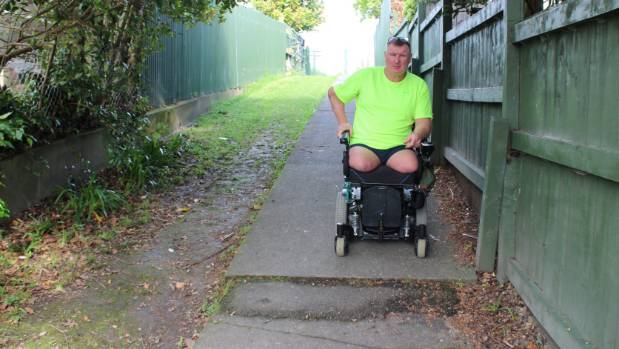 Ian Winson says the approximately 45-metre walkway is challenging to navigate when he goes to pick up his kids from school.