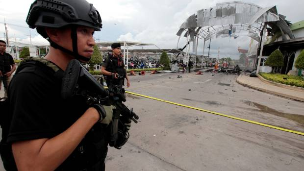 Security forces are seen at a blast site outside a supermarket in Pattani, Thailand.