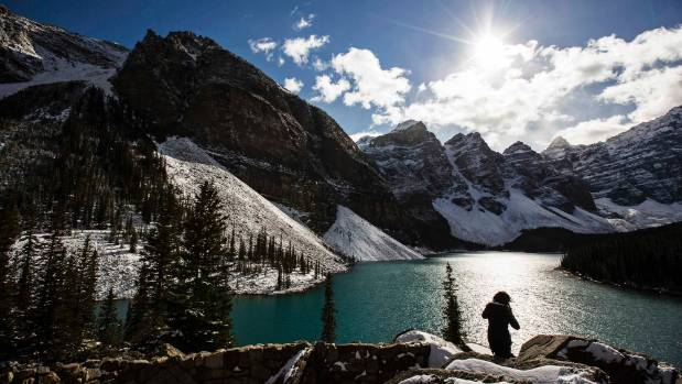 Banff in the Canadian Rocky Mountains is home to idyllic lakes and landscapes, popular year-round.