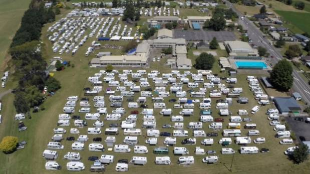 Hundreds of campervans attending a Music in the Mountains Festival at the Tapawera Area School illustrate the financial ...
