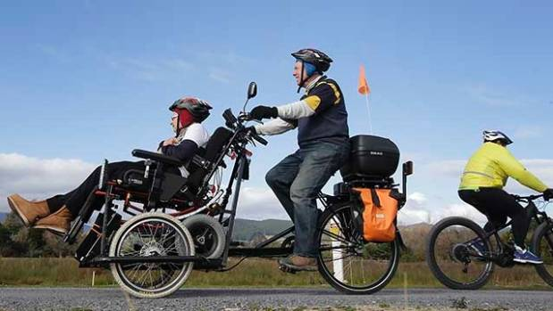 Waikanae Beach's John and Avis Darnley on an e-bike that allows the couple to cycle together. (File photo)
